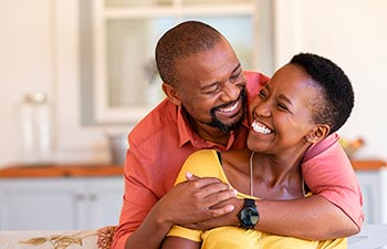 A happy middle-aged Afro-American couple.