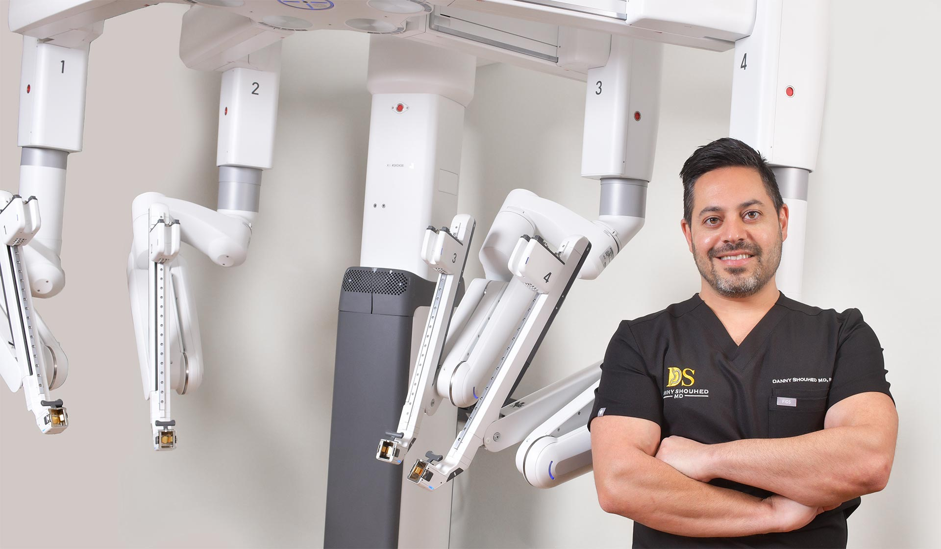 Danny Shouhed MD with robotic surgical system he uses for surgical procedures.