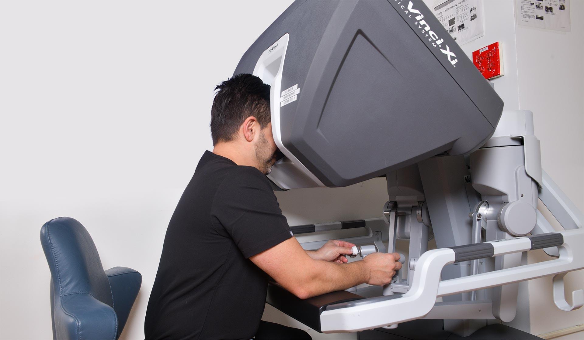 Danny Shouhed MD with Da Vinci robotic surgical system.